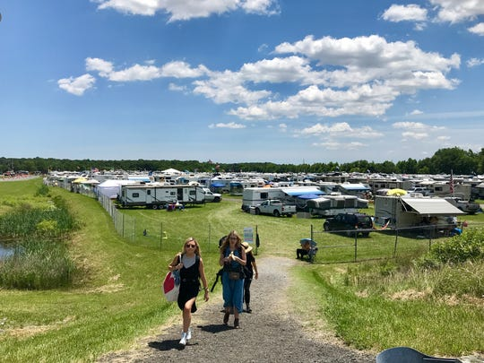 Campers leave Lot 9 near Del. 1 Friday, heading into the Firefly Music Festival grounds.