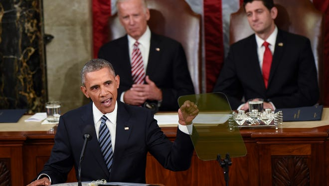 President Barack Obama gestures while giving State of the Union address before a joint session of Congress on Capitol Hill in Washington, Tuesday, Jan. 12, 2016. Vice President Joe Biden and House Speaker Paul Ryan of Wis. listen at rear.