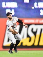 Tigers centerfielder Tyler Collins (18) catches a ball