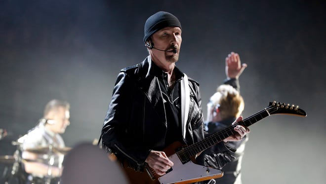 In this Sunday, Dec. 6, 2015 file photo, The Edge of U2 performs on stage during a concert, in Paris, Sunday, Dec. 6, 2015. The Sierra Club is suing the California Coastal Commission in an effort to halt approval of U2 guitarist The Edge's plans to build five mansions on a Malibu ridge, Thursday, Jan. 21, 2016.  (AP Photo/Thibault Camus, File)