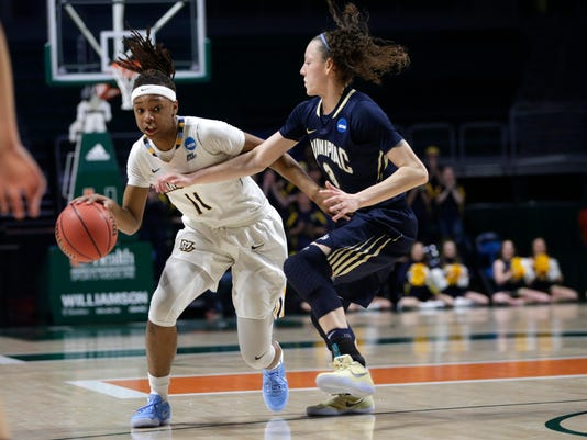 Marquette's Allazia Blockton (11) drives to the basket as Quinnipiac's Adily Martucci (3) defends during the first half of a first round game in the NCAA women's college basketball tournament, Saturday, March 18, 2017, in Coral Gables, Fla. (AP Photo/Lynne Sladky)