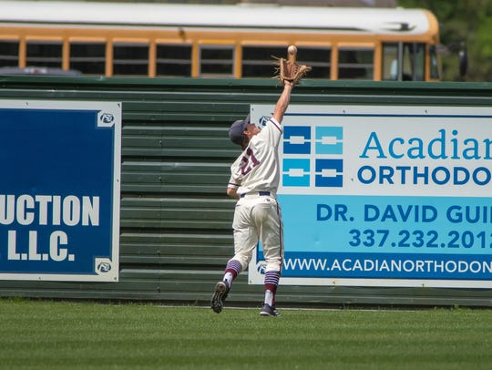 STM's Rhett Lacomb attempts to catch a flyball in the
