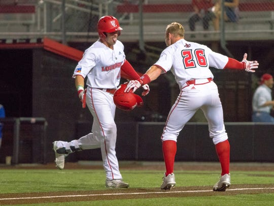 UL's Daniel Lahare (right) celebrates with Gavin Bourgeois (left) after Bourgeois' two-run squeeze bunt in a win last month over the University of New Orleans.