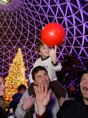A light show and wandering performers are part of the family-friendly fun at New Year's Eve at the Mitchell Park Domes.