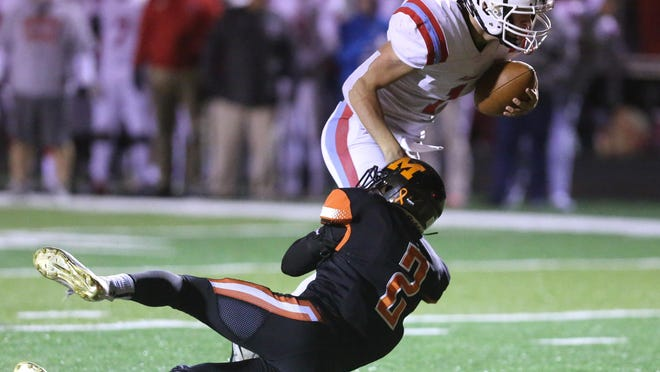 Alliance's Braidyn Hartsoe runs close to the goal line before being taken down by Marlington's Nick Mudrick  during the second quarter of their game at Marlington on Friday, Nov. 1, 2019. Hartsoe scored on the next play.