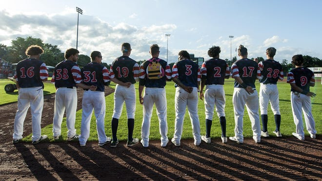 The team lines up to listen to the national anthem during the baseball game between the Williamsport Crosscutters and the Vermont Lake Monsters at Centennial Field on July 14, 2016 in Burlington.