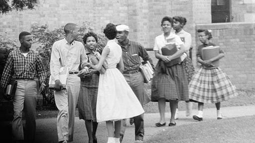 Eight of the nine black students who have been attending Central High School in Little Rock, Ark., are shown as they walked from school to their waiting Army station wagon, Oct. 2, 1957.