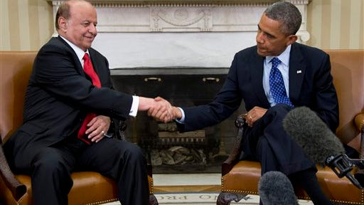 President Barack Obama and Yemen's president, Abdo Rabby Mansour Hadi, shake hands as they speak to the media in the Oval Office in 2013.