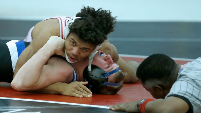 145 Lb Division 1- Penfield's Frankie Gissendanner defeated Brockport's Troy Ferris during the Wrestling SuperSectionals The College at Brockport.