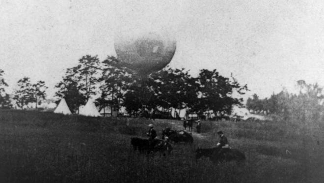 """Prof. Thaddeus Lowe's """"Balloon Camp"""" at Gaines Mill, Va., May 1862: balloon in backgrd. across field; Union horsemen in foregrd."""