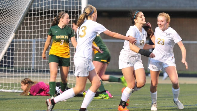 Roberson players Sarah Lewis (23), Amanda Prichard (18) and Abby Haines celebrate during Wednesday's 2-0 shutout of visiting Reynolds.