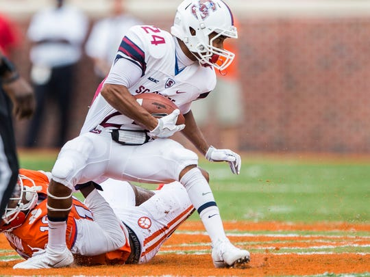 SC State wide receiver Lynard Jamison (24) is tackled by Clemson safety Jadar Johnson (18) during the Clemson game against South Carolina State on Saturday, September 17, 2016 in Clemson.