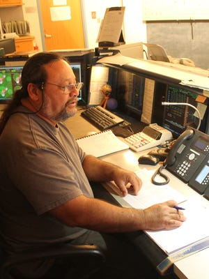 In this 2015 file photo, Guam Power Authority generation dispatcher Richard Iriarte monitors the power output of the Cabras 1 generator while at the power agency's Power System Control Center.