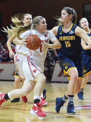 Marist College's Claire Oberdorf drives against Canisius' Lauren D'Hont  last year.