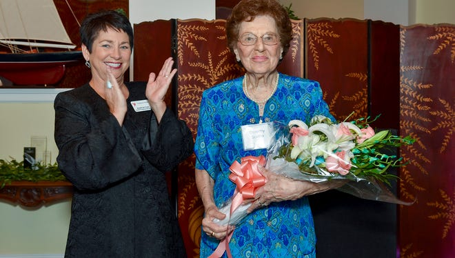 Dorothy Scotto, right, receives the Thanks for Giving award presented by Susan de Cuba, left, Treasure Health president and CEO.