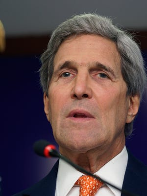 U.S. Secretary of State John Kerry speaks at a press conference in Gandhinagar, India, Monday, Jan. 12, 2015. Kerry said he will travel to Paris this week for talks on countering extremist violence, following sharp criticism of the Obama administration for not sending a senior official to Sunday's rally for unity in Paris that was attended by some 40 world leaders and more than a million people.