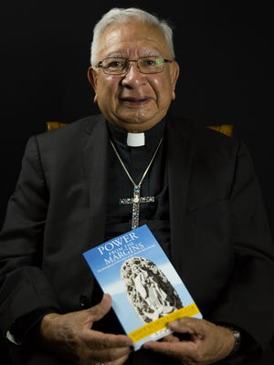 """Bishop Emeritus Ricardo Ramírez reads from his new book """"Power From The Margins."""" The Catholic Diocese will be holding celebrations Sept. 8 and 11 to mark a number of milestones for Ramírez, including his 80th birthday and the publication of his first book."""