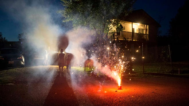 Jul 4, 2017; Los Ebanos, Texas; Reyden (8, left) and Jason Borrego (3) watch fireworks from the front yard of their Los Ebanos, Texas. Mandatory Credit: Mark Henle/The Arizona Republic via USA TODAY NETWORK