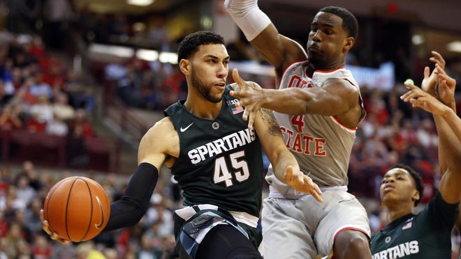 Michigan State's Denzel Valentine speeds past Ohio State center Daniel Giddens during the second half of the Spartans' 81-62 win Feb. 23 at Value City. Valentine plays his final game at Breslin Center today when the Buckeyes visit.