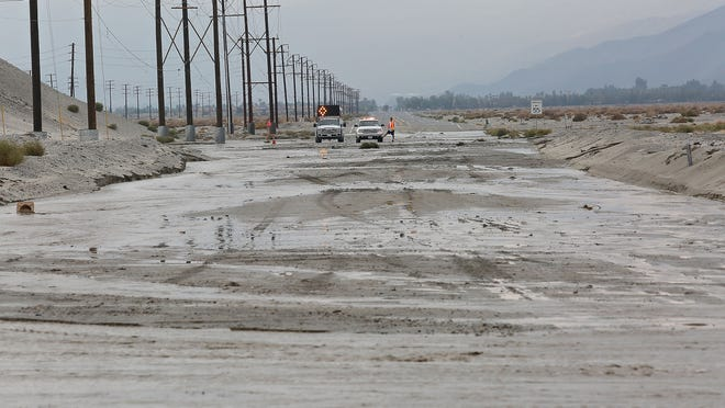 Mud and water flooded Indian Canyon, Wednesday morning, December 3, 2014.