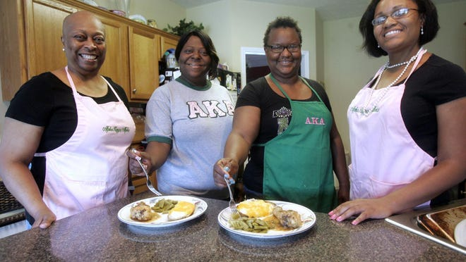 AKA members, from left, Brenda McKinney, Rochelle Walton, Deborah King and Danielle Harris prepare for Taste of AKA a few years ago. This year's event is June 13.