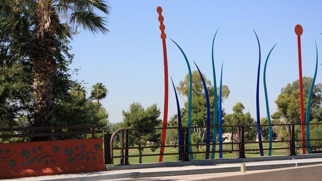 """Artist Stacy Levy's work titled """"Swale"""" was installed on the Thomas Road Bridge in 2014. The colorful art represents tall grass and seed pods."""