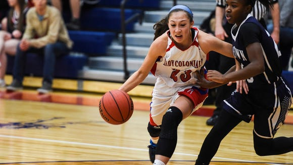 New Oxford's Emily Clinton, left, along with her Colonial teammates are  ranked No. 5 in the most recent District 3 Class AAAA Girls Basketball Power Rankings. Also pictured, Debria Hendricks and the Dallastown Wildcats, are ranked No. 6.  (Shane Dunlap -GameTimePA.com)