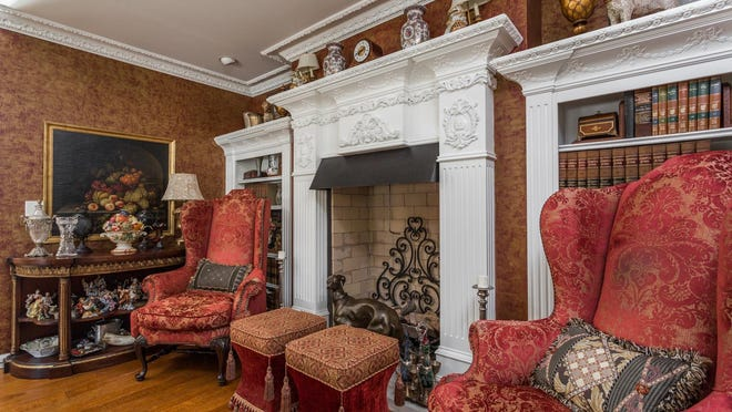 The ornate dining room features a fireplace.