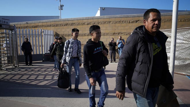 A group of migrants that were requesting asylum are returned to Mexico at El Chaparral port of entry in Tijuana. The individuals will wait in Mexico until their scheduled court date in the United States. A judge in California on Monday blocked a Trump administration policy requiring some asylum-seekers to wait in Mexico for their hearings in the U.S. (Nelvin C. Cepeda/San Diego Union-Tribune/TNS)