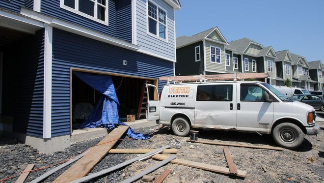 In Middletown, electricians and other workers on Tuesday returned to unfinished townhouses at the 158-home Magnolia Park project to pick up where they left off on construction in March.