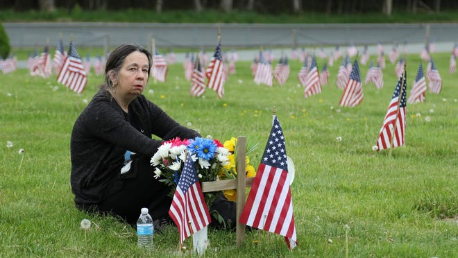 Debra Soto of Loch Sheldrake came to the Sullivan County Veterans Cemetery in Liberty to visit her husband Edward's grave on Monday. She goes to his gravesiteevery day. JIM SABASTIAN/FOR THE TIMES HERALD-RECORD