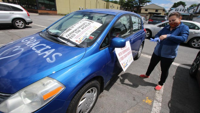 Janet Hernandez, of Liberty, wrote and put signs on her car before the start of the caravan in South Fallsburg on Sunday. JIM SABASTIAN/FOR THE TIMES HERALD-RECORD