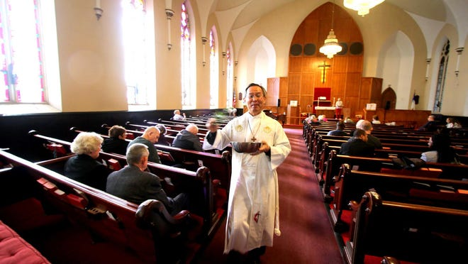 Pastor Charles Ryu, sprinkled holy water on the congregation during a Sunday service at St. Paul's  United Methodist Church in Middletown. N.Y. Jan. 12, 2020. There was approximately 35 people in attendance. JIM SABASTIAN/FOR THE TIMES HERALD-RECORD