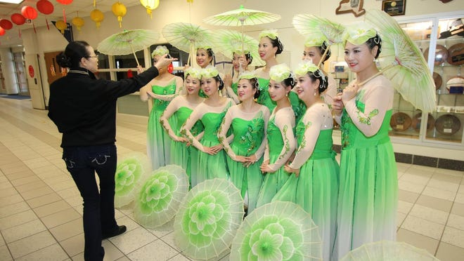 Dance instructor Nina Yinggli Li, left, rehearses with her troupe before the Chinese New Year celebration on Saturday.