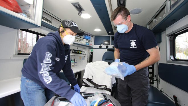 Marbletown First Aid Unit Chief Karen Pardine, left, and EMT Justin Rearick check the equipmentinside the ambulance recently. The unit is recruiting experienced emergency medical technicians, drivers and volunteers for the expected surge in COVID-19 patients.