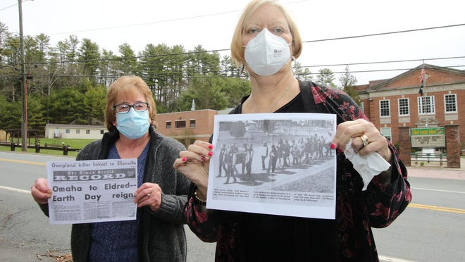 Thomasina Cyrek, left and her friend Linda Leavenworth-Bohs, show copies of a Times Herald-Record article and photo that they were featured in. It was shot outside of Eldred High School 50 years ago on the first Earth Day. They marched alongRoute 55 to raise awareness for protecting the earth. Today, wearing protective face masks because of coronavirus, he two say they still support the Earth Day message.