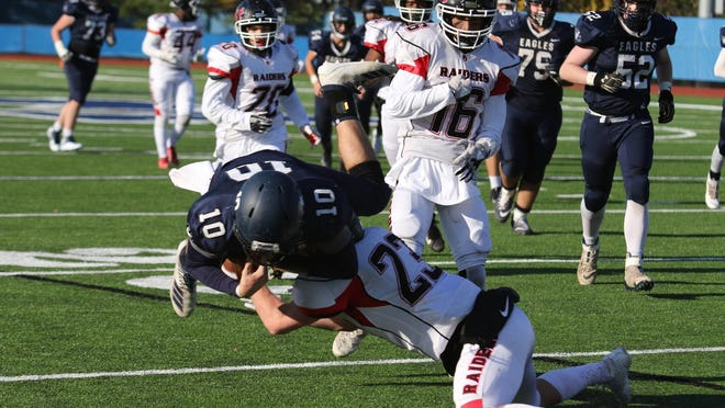 Port Jervis' Ryan Costello makes a tackle against Burke during a game this past season.