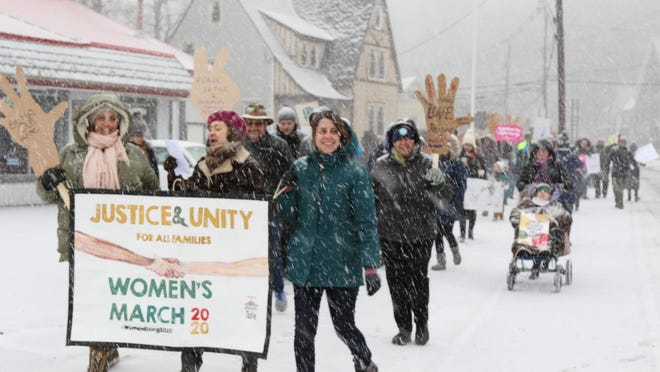 Hundreds walk Saturday morning along the snowy streets of Port Jervis.