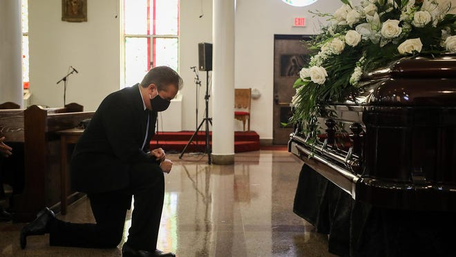 Charles Villaseñor prays before the funeral service for his mother, Lois Villaseñor, at Our Lady of Guadalupe Catholic Church Thursday in East Austin. Lois Villaseñor, who founded Mission Funeral Home in 1959 with her husband, died in July of COVID-19-related complications. She was 87.