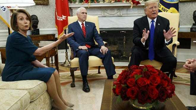 As Vice President Mike Pence (center) looks on, then-House Minority Leader Rep. Nancy Pelosi, D-Calif., argues with President Donald Trump during a meeting in the Oval Office in 2018. Trump and Pelosi both are expected to be in South Florida this weekend as the Super Bowl takes place in Miami Gardens.