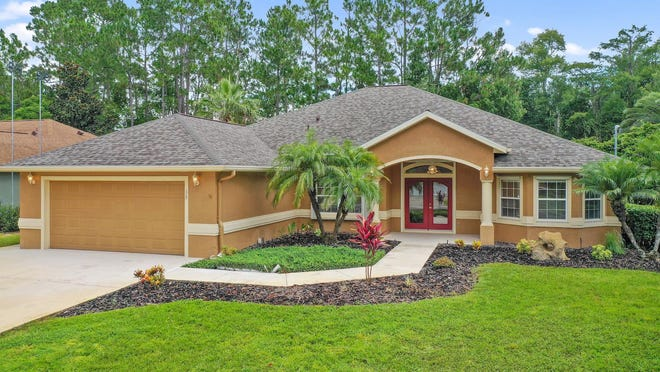 This beautiful, well-appointed pool home has scenic views of the Cypress Knolls golf course and is loaded of extras.