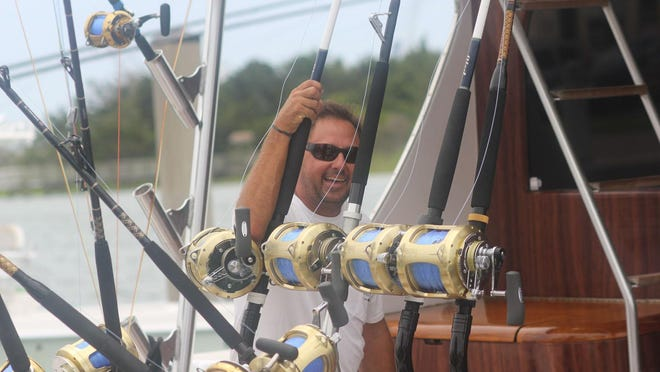 "Captain Walker ""Skipper"" Gentry hangs out on the Carolina Gentleman during a lay day Wednesday at the Big Rock Blue Marlin Tournament."
