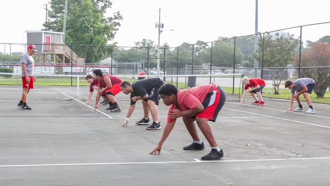 Jacksonville's football team started summer workouts last week while practicing social distancing.