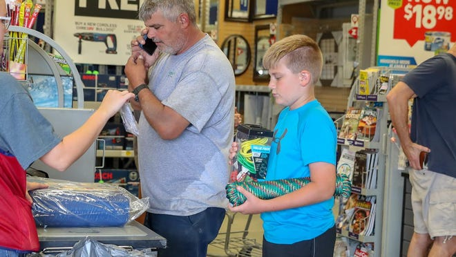 Robert Morton and his son Brayden, 10, purchase supplies in preparation for hurricane Dorian.  As residents of Onslow County prepare for the approaching hurricane many are finding items are running low, on back order or are out of stock.  Many are awaiting delivery of items such as bottled water, gas and generators.