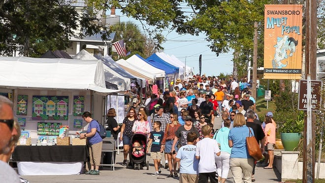 Swansboro 2019 Mullet Festival brought out thousands as vendors, food, music, and attractions lined the streets of downtown Swansboro.