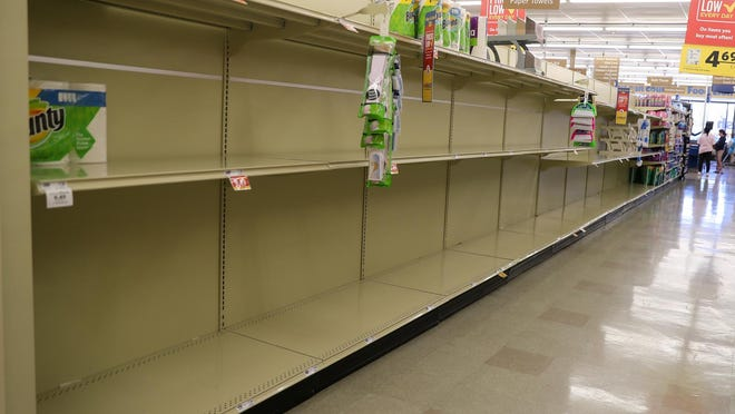 Shoppers find bare shelves at their local stores. Items such as cough drops, water, toilet paper, Clorox, wipes and hand sanitizers were amongst a few of the hard to find items during the early days of the pandemic.