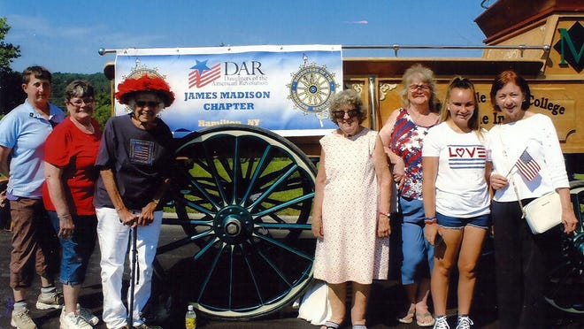 James Madison chapter of the National Society of the Daughters of the American Revolution members, from left, Gail Merian, Ellen Coughlin, Lillian Townsend, Catherine Jenne, Joyce Norris, Betty Sherrod's granddaughter Madison DeAngelis and Betty Sherrod pose in July 2019.