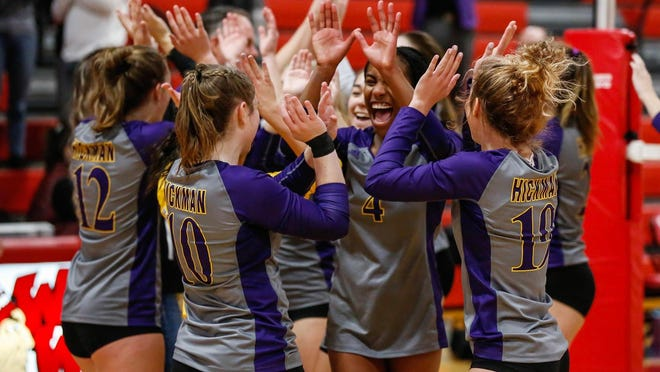 Hickman's Jerica Jackson (4) and her teammates celebrate after the Kewpies swept Hannibal in the Class 4 District 8 championship last season in Warrenton.