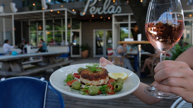 A crab cake on the socially distanced patio at Perla's on South Congress Avenue.