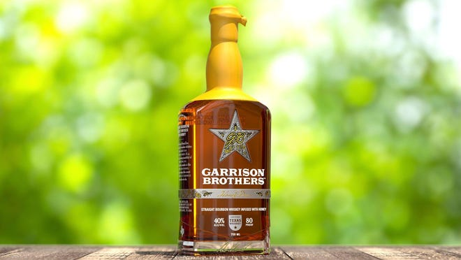 Garrison Brothers is launching HoneyDew, a new honey-sweetened bourbon nationally this summer. Customers can pick it up at the distillery in Hye on July 18, and it will be in stores the following week.